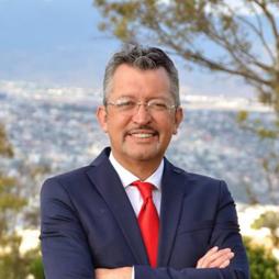 Dr. Hector Milla